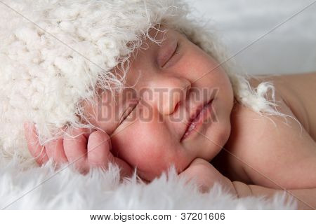 Close Up Of Newborn Baby Peacefully Sleeping