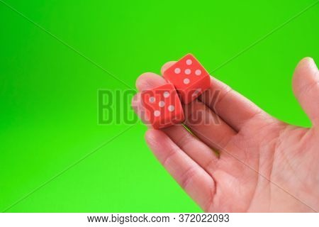 Games Of Chance.gambling Game Concept. Good Luck And Luck.board Games.cubes In A Hand On A Bright Gr