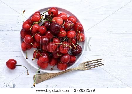 Fresh Juicy Red Cherries Served For Breakfast On White Wooden Background/ Red Fresh Cherries Sweet C