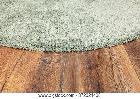 Detail Of Green Carpet On Wooden Floor In Living Room, Interior Decoration.