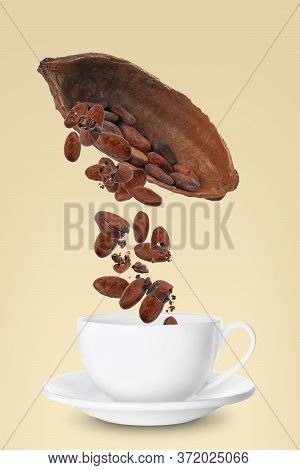Cocoa Pod And Beans Falling Into Cup On Yellow Background