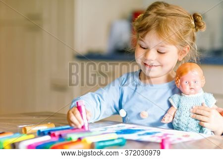 Little Alone Toddler Girl Painting With Felt Pens During Pandemic Coronavirus Quarantine Disease. Ha