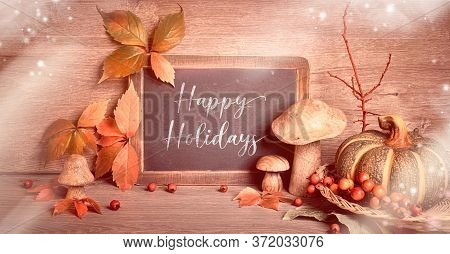Autumn Traditional Decorations, Toned Panoramic Image. Text Happy Holidays On Blackboard. Fall Leave