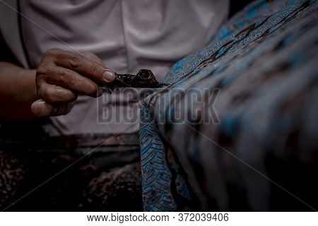 Indonesia June 18, 2020 : Batik, Close Up Hand And Canting, Making Batik Tulis Indonesia. Canting Is