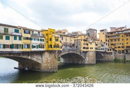 Iconic Vecchio Bridge In Florence Over River Arno Called Ponte Vecchio - Tuscany, Italy