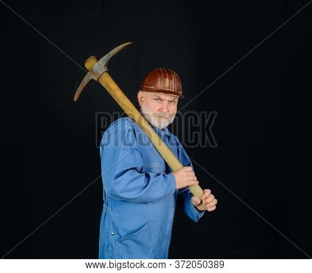 Construction Worker Holds Pickaxe. Man Contractor With Axe. Smiling Workman With Pickaxe. Constructi