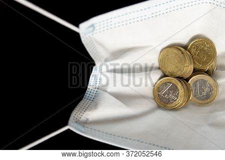 Medical Face Mask With Money, Black Background. World Coronavirus Economic Losses Concept. Concept O