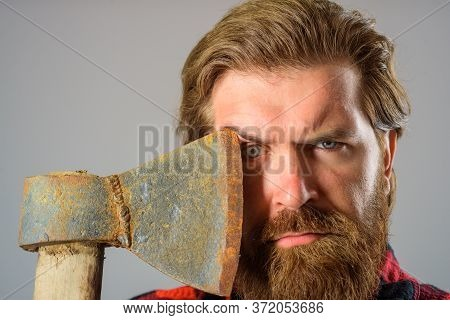 Man With Ax. Bearded Lumberjack. Bearded Man With Ax Beside Face. Close Up Portrait Of Man With Ax