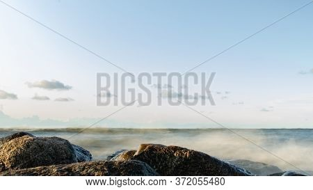 Fluffy Sea Water, Rocks Foreground, Blue Sky
