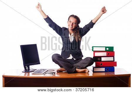 Woman meditating on the desk