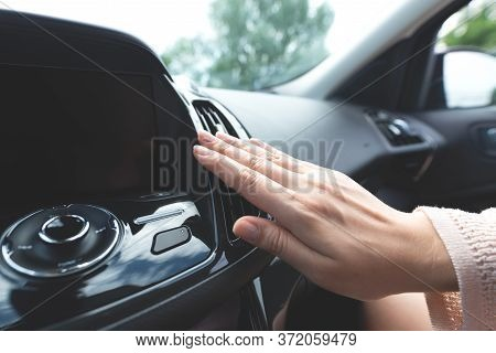 Car Air Conditioning. Woman Checks Air Conditioning In A Car