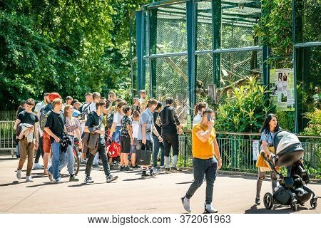 People In Front Of A Cage At Lyon Zoo Of Tete D'or Public Garden After The On Reopening Weekend In F