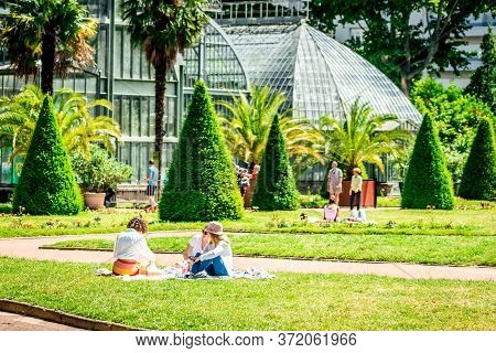 Group Of People Lying On The Grass Of Tete D'or Public Garden After The Reopening Due To Covid-19 Lo