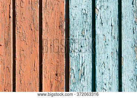 Old Peeling Paint Texture. Grunge Cracked Wooden Wall Background. Blue And Red Color Divided Weather