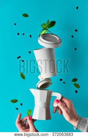 Balancing Zero Waste Coffee Pyramid In Female Hands On Blue Mint Background. Ceramic Espresso Coffee