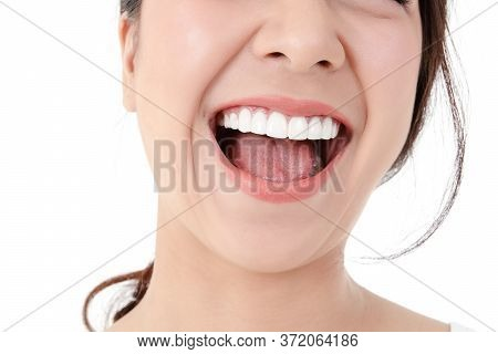 Asian Women Have Beautiful Smiles, Clean White Teeth, Pink Lips. Healthy Skin. Dental Care Concept,