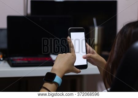 Young Woman Working From Home Using Smart Phone And Laptop Computer, Girl Hands Holding White Screen
