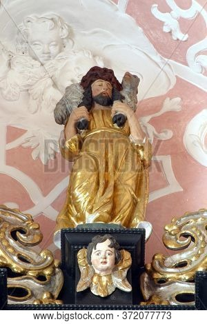 ZAGREB, CROATIA - MAY 16, 2013: Jesus the Good Shepherd, statue on the altar of the Holy Spirit in the Church of Saint Catherine of Alexandria in Zagreb, Croatia