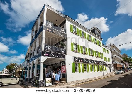 Nassau, Bahamas - May 3, 2019: Street View Of Nassau At Day With People Near A Clothes And Souvenir