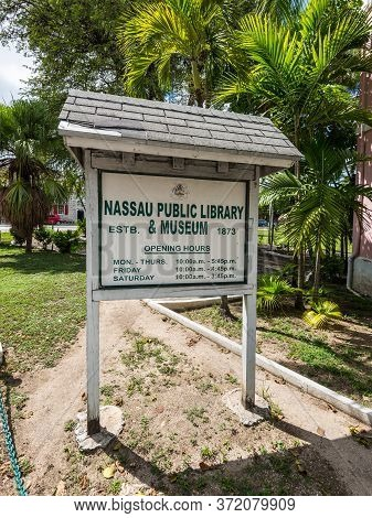 Nassau, Bahamas - May 3, 2019: Signboard Of The Nassau Public Library & Museum With Opening Hours In