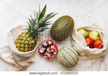 Fresh Seasonal Fruits (pineapple, Green Apples, Pomegranate, Peaches And Melon) In Eco Friendly And