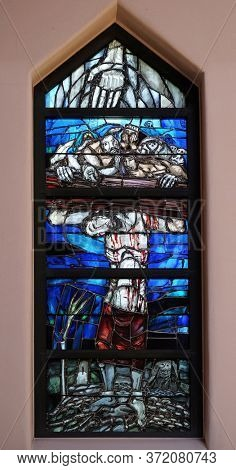 PIFLAS, GERMANY - JUNE 07, 2015: God gives people new life, stained glass window by Sieger Koder in church of Saint John in Piflas, Germany