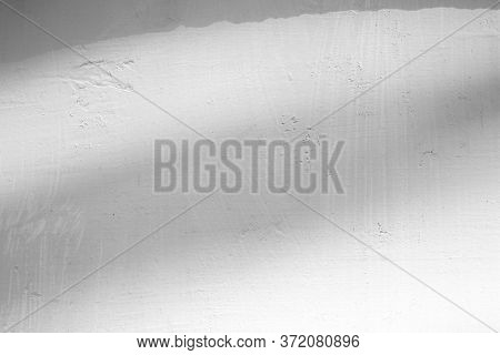 Light Beam And Shadow On White Concrete Wall Texture Background, Suitable For Overlay, Product Prese