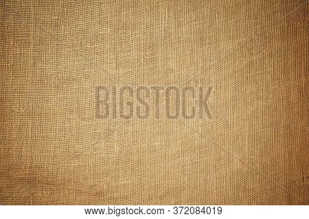 Old Brown Coarse Burlap Canvas Texture Background.