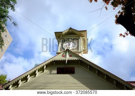 Sapporo Clock Tower In Cloudy Day Where Is Famous Tourist Attraction In Hokkaido, Japan.