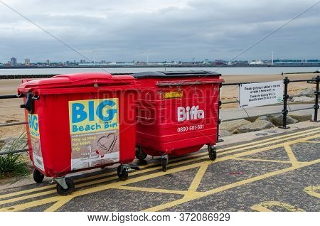 New Brighton, Uk: Jun 3, 2020: A Pair Of Commercial Trash Bins Are Available For Public Use On The P