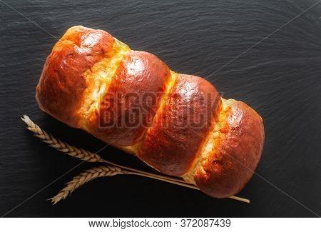 Food Baking Concept Fresh Baked Organic Homemade Soft Milk Loaf Bread In Loaf On Black Slate Board W