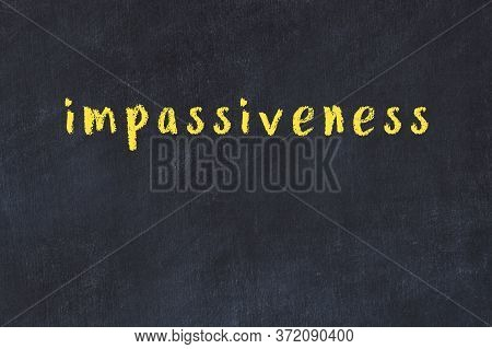 Chalk Handwritten Inscription Impassiveness On Black Desk