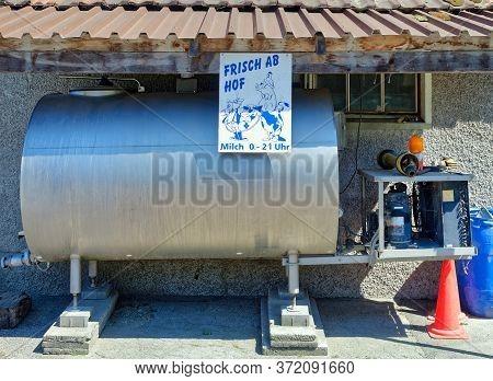 Bern, Switzerland - May 31, 2020: Dairy Tank On A Organic Farm Where Fresh Milk Can Be Bought Direct
