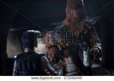 JUNE 20 2020: Star Wars pirates Hondo Ohnaka confronted by Han Solo and Chewbacca at Mos Eisely - Hasbro action figures