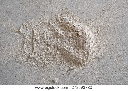 Small Pile Of Construction Plaster On The Floor