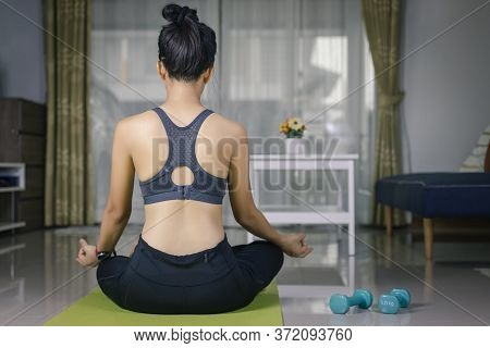 International Day Of Yoga Concept Asian Woman Doing Meditation For Yoga Athlete Sitting On An Exerci