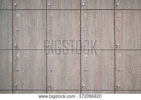 Wooden Lockers In Locker Room At Office.