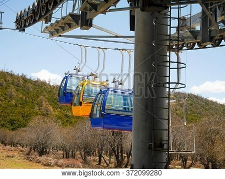 Cable Car Or Aerial Tram Coming At The Station On Shika Snow Mountain, Shangri-la, Yunnan, China