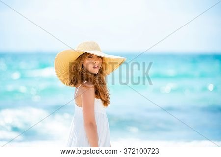 Portrait Of A Beautiful Woman In A Straw Hat. Beautiful Redhead Woman In Hat At The Sea. Woman Sensu
