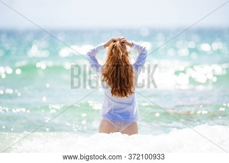 Young Girl Feels Happy On Sea. Vogue Fashion Style Portrait Of Summer Girl. Travel Lifestyle, Swimmi