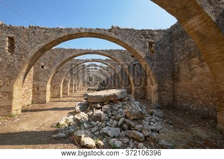 Arcadi Monastery In Crete, Greece, Stone Arches In Monastery Garden