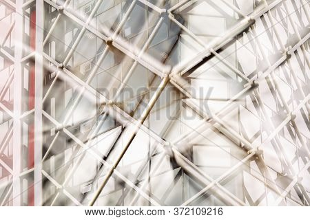 Architectural abstract. Modern building exterior with hazy coloured lighting filter and double exposure effect.