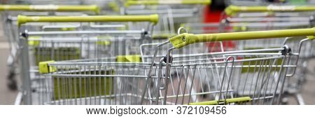 Shopping Carts In Supermarket Are Standing Street. Equipment For Customer Service In Shopping Center