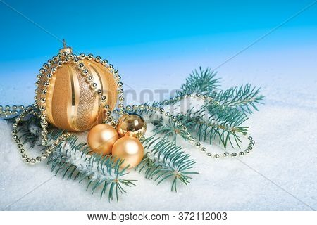 Shiny Sparkling Golden Christmas Baubles And Trinkets, Wintertime Arrangement. Abstract Winter Blue