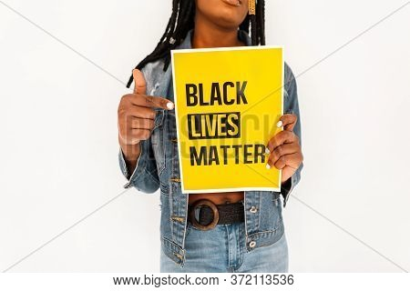 Closeup Of A Yellow Poster With Text Black Lives Matter Against Violence In Hands Of African America
