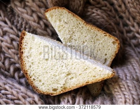 Bread Slices On A Knitted Material Top View