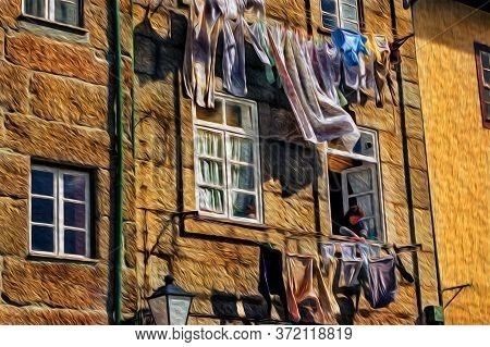 Woman At The Window Of Her House Hanging Clothes On The Clothesline In Lisbon. An Old City Located A