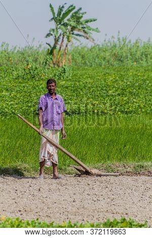 Jamuna, Bangladesh - November 7, 2016: Local Peasant On A Char Sandbank Island In Jamuna River Near