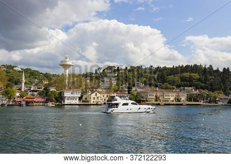 Istanbul, Turkey - October 6, 2019: White Yacht Going At Bosphorus Strait In Istanbul, Turkey. Popul