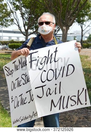 Fremont, Ca - June 15, 2020: Protestor Outside The North Gate Of The Tesla Factory Wearing Face Mask